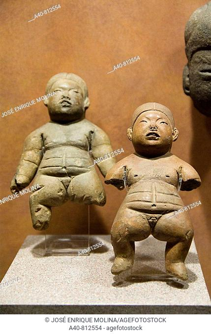 Mexico.Mexico city.National Museum of Antropology.Olmec culture.Terracotta figurines representing girls