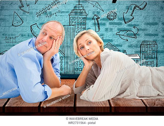 Composite image of Mature couple against a wall with sketches