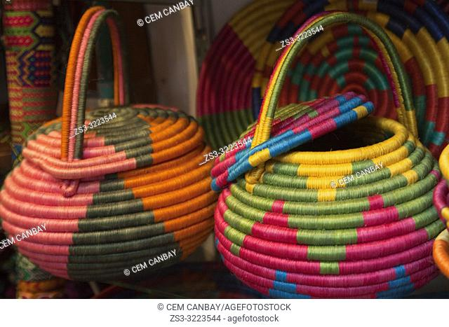 Colorful traditional baskets in the shop at the Art and Craft market at the historic center, Bogota, Cundinamarca, Colombia, South America
