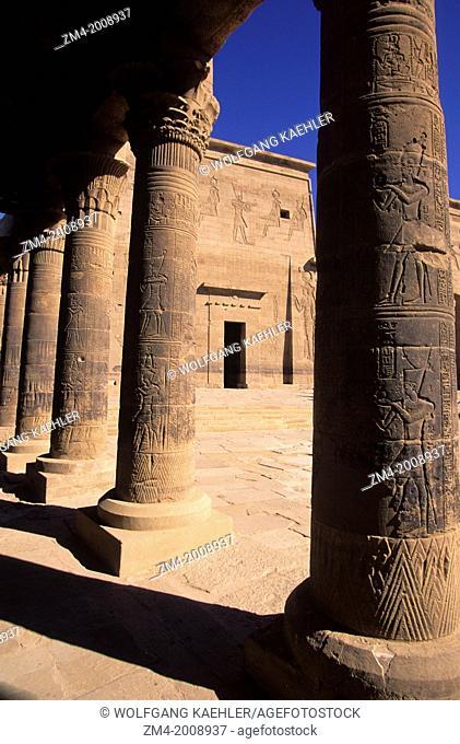 EGYPT, ASWAN, NILE RIVER, AGILKIA ISLAND, PHILAE, WEST COLONNADE VIEW OF FIRST PYLON