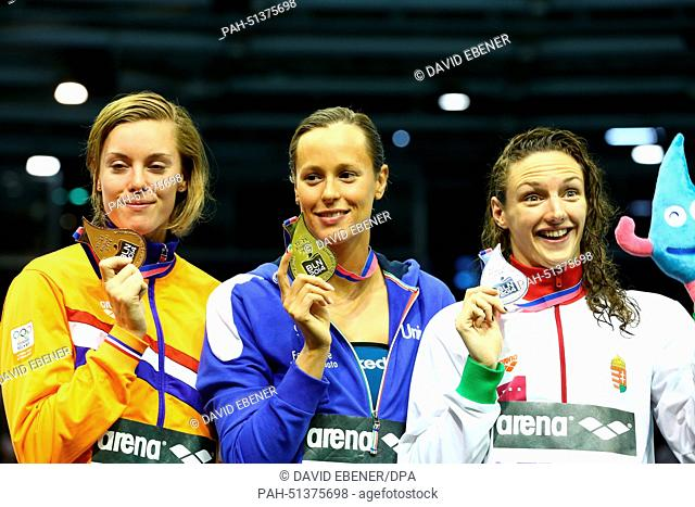 Winner Federica Pellegrini of Italy (C), second placed Katinka Hosszu of Hungary (R) and third placed Femke Heemskerk of Netherlands show their medals for the...