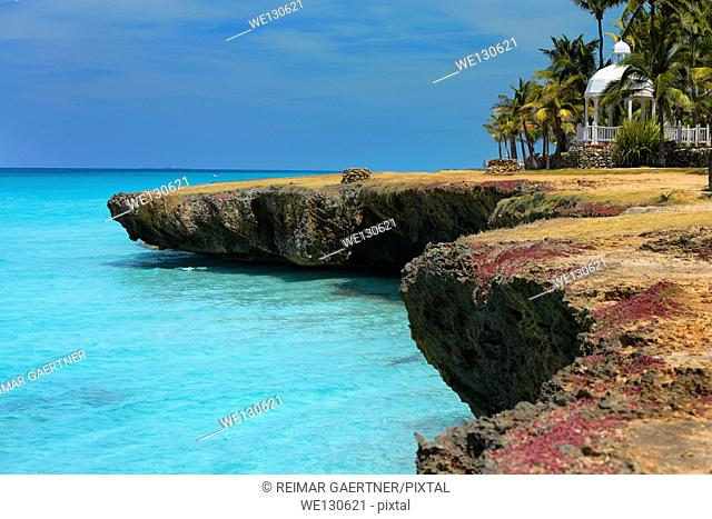 Lava rock shore with blow hole wells Palm trees and gazebo at Varadero Cuba resort