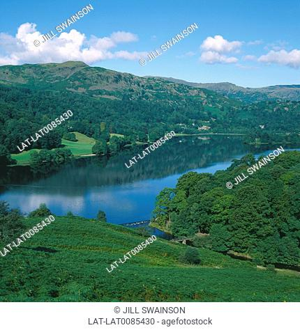 Lake District. Grasmere. View over lake. Calm water,reflections. Wooded slopes