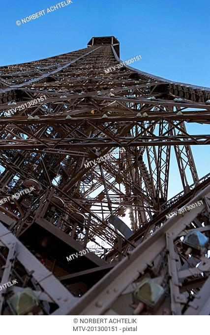 Directly below shot of Eiffel Tower against blue sky, Paris, France