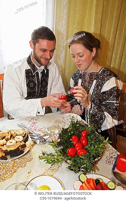 Romania,Moldavia Region,Southern Bucovina,near Campulung,Easter Monday Celebration,traditional breakfast,traditional costumes,folklore,painted Easter eggs