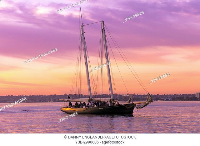 The schooner 'America' at sunset in San Diego Bay, California
