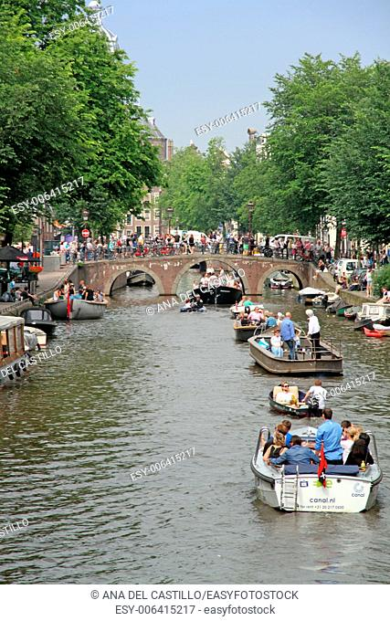 Amstel canal with boats on Saturday 7 June 2014, in Amsterdam Holland