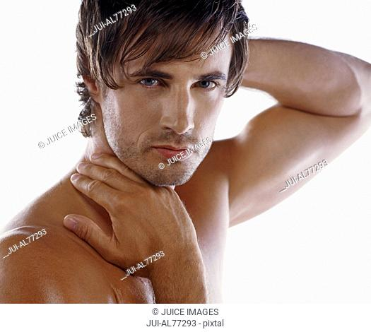 Man with bare chest posing