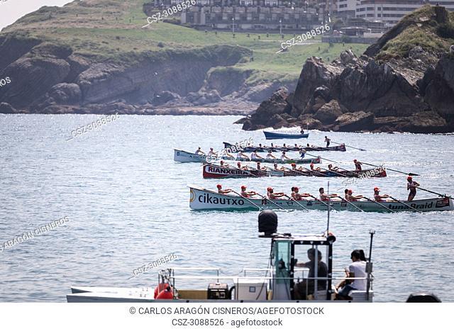 CASTRO URDIALES, SPAIN - JULY 15, 2018: Start competition of boats, regata of trainera, Ondarroa Cikautxo, Cabo, Donostiarra and Santurtzi Iberdrola boats in...