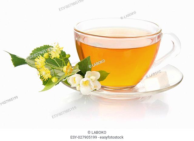 Cup of tea with a saucer and the jasmine and linden flower, isolated on white