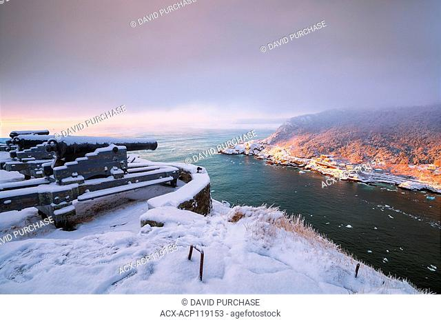 Sunrise on snow covered morning at the Queens Battery & Barracks, Signal Hill National Historic Site, St. John's, Newfoundland and Labrador