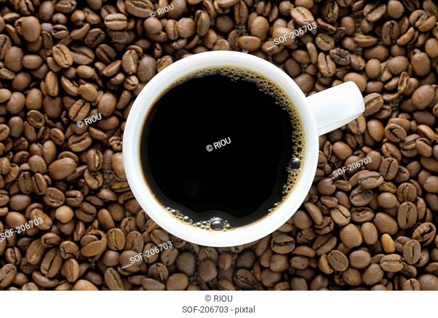 Cup of coffe and coffee beans