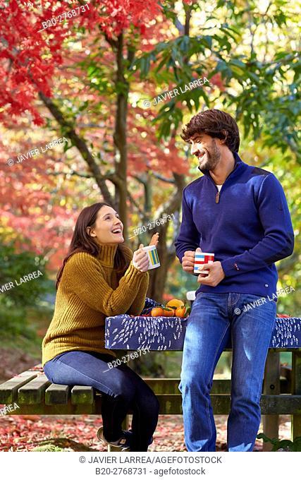 Couple picnic in the forest, Autumn, Pagoetako Parke Naturala, Pagoeta Natural Park, Aya, Gipuzkoa, Basque Country, Spain