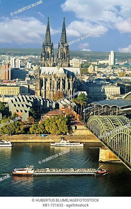 view over thr river Rhine to Cologne Cathedral and Museum Ludwig, right Hohenzollern bridge, Cologne, Northrhine-Westfalia, Germany