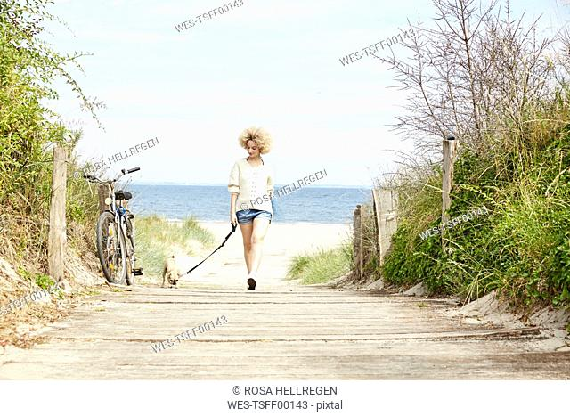 Young woman going walkies with her dog