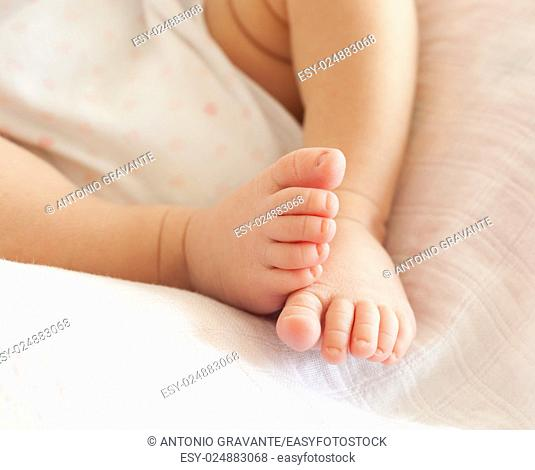 Close up of tiny baby feet. The foots of newborn