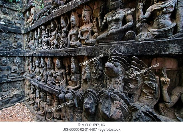Sandstone bas relief of male figures, Deities & Nagas of the underworld on the hidden wall at the Leper King Terrace, part of the Royal Square of Angkor Thom -...