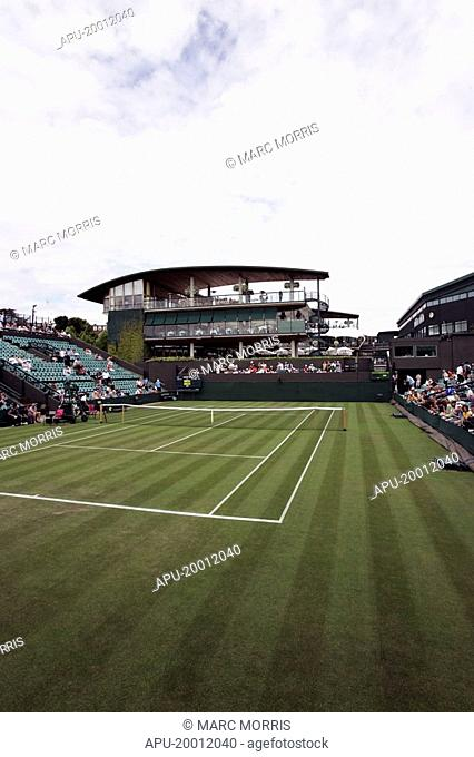 Grass tennis court with a stadia