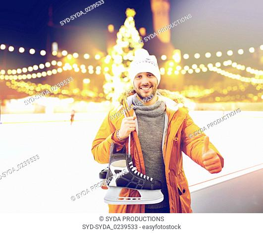man showing thumbs up on christmas skating rink