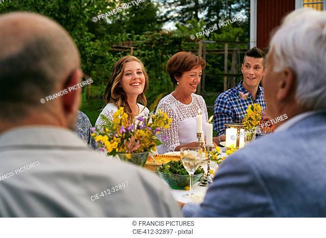Woman enjoying family garden party dinner