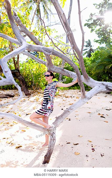 European woman, Seychelles, Praslin, beach photo shooting, sunrise, fashion