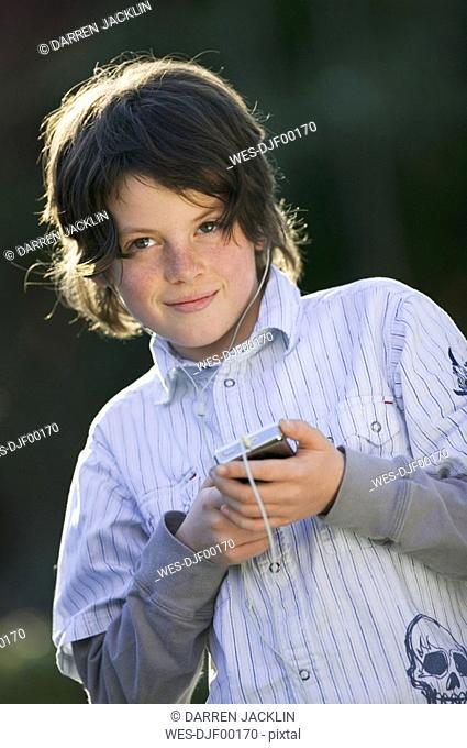 Boy 10-11 using mp3-player