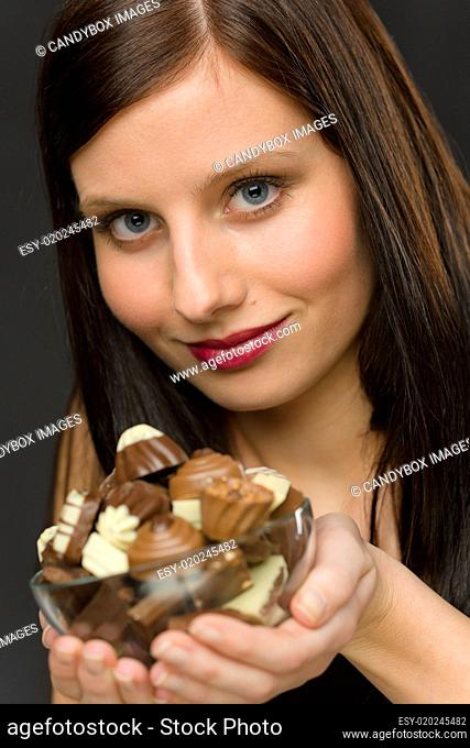 Chocolate - portrait young woman hold candy