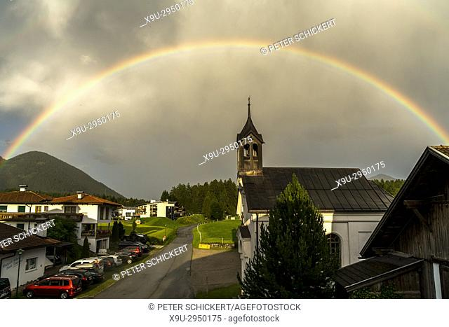 rainbow and the church in Obsteig Holzleiten, Tyrol, Austria