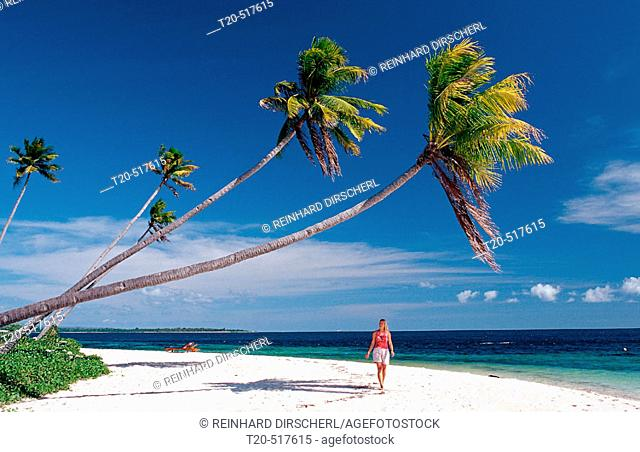 Woman on the sandy beach. Wakatobi Dive Resort, Sulawesi, Indian Ocean, Bandasea. Indonesia