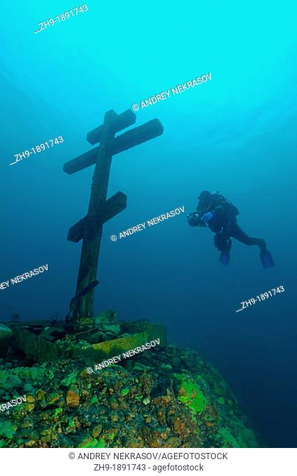 The diver looks at a cross 'This cross is consecrated and established on Feast of the Ascension 09 06 2005'  Lake Baikal, Siberia, the Russian Federation