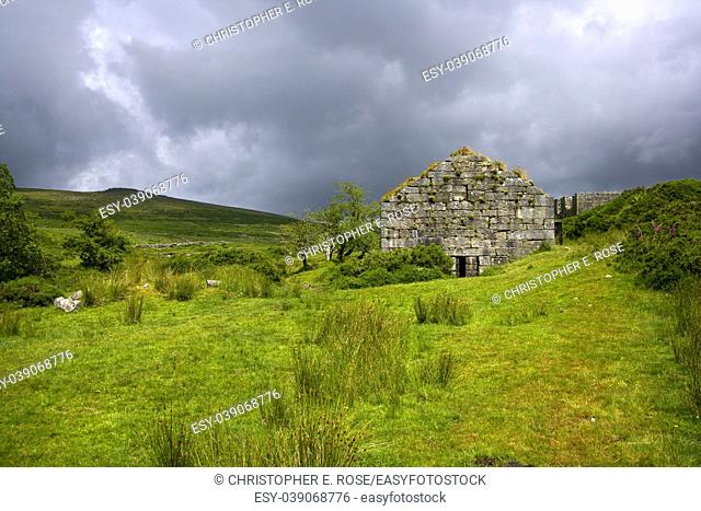 UK, Devon, Dartmoor, a stormy sky over industrial heritage ruins at Powder Mills near Postbridge