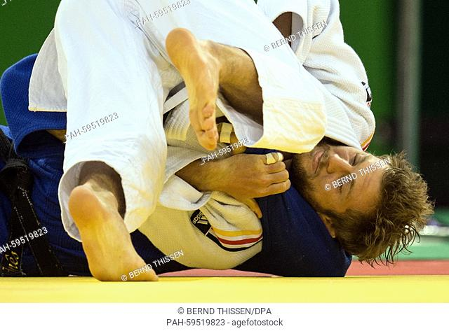 Germanys Sebastian Seidl (white) competes with Sergiu Oleinic of Portugal in the Men's -66kg Judo Bronze Medal Final B at the Baku 2015 European Games in Heydar...