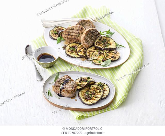 Grilled beef medallions in largo and aubergines