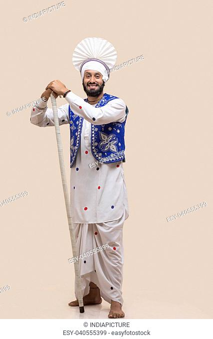 Standing Of Sikh man with Stick