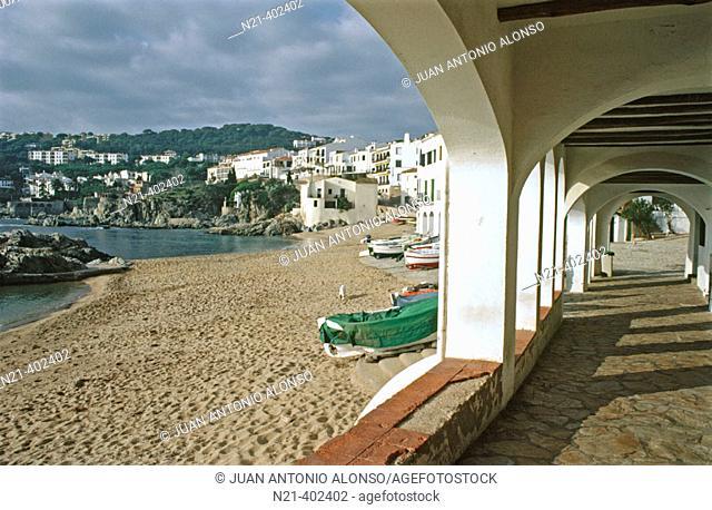 Arcade and boats. Calella de Palafrugell. Girona province. Spain