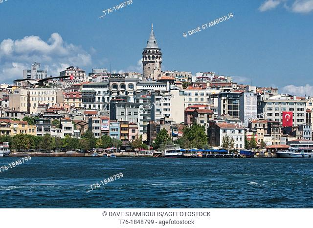 view of the Galata Tower and Beyoglu across the Bosphorous in Istanbul, Turkey