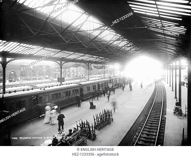 Waterloo Station, York Road, Lambeth, London, c1870-1900. An interior view showing trains pulled into the platforms and people alighting from and entering the...
