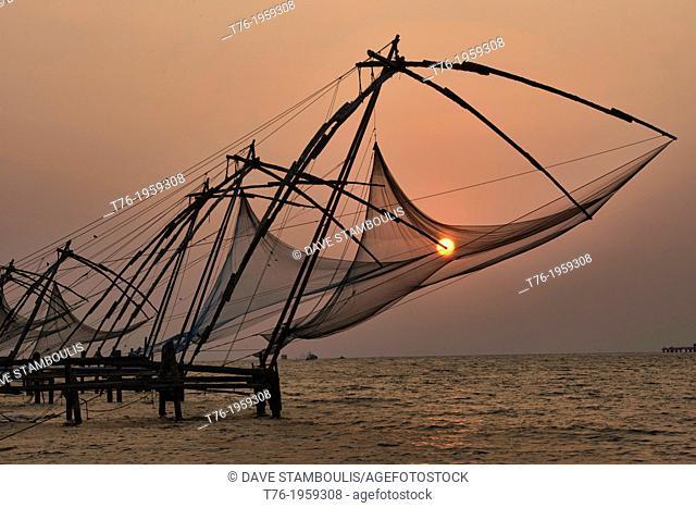 Chinese fish nets at sunset in Fort Cochin (Kochi) in Kerala, India
