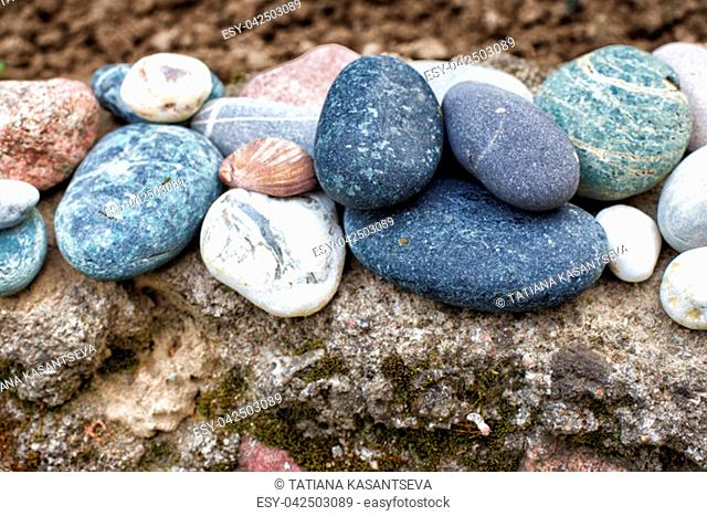 Background from sea stones for design. Pyramid from sea stones