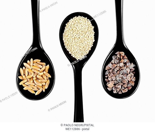 Black japanese style spoons of Kamut wheat,Quinoia, buckwheat, grains
