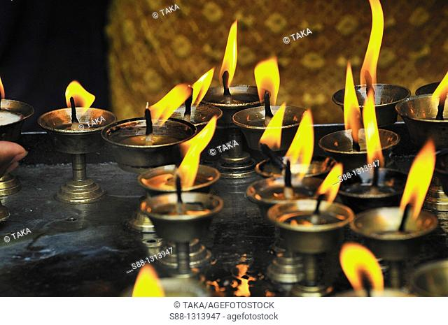 Candle flames at the temple