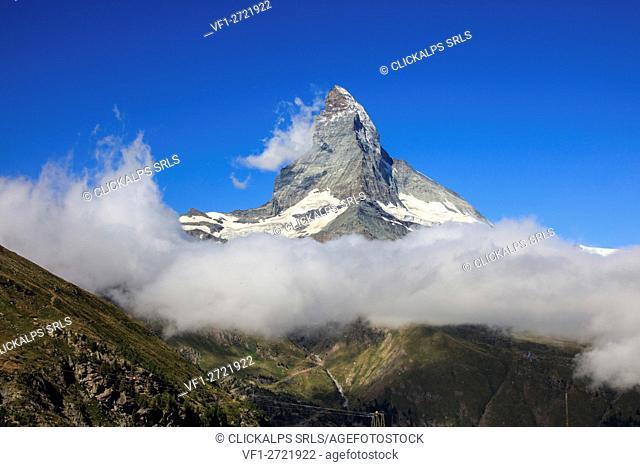 View of Matterhorn framed by clouds and blue sky in a summer day Gornergrat Valais Switzerland Europe