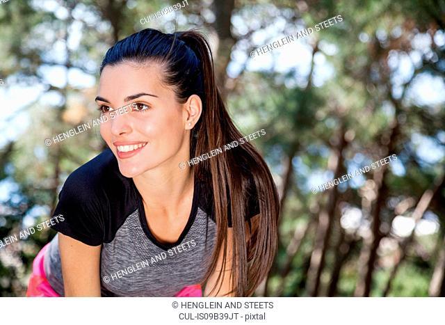 Young female runner taking a break in park, Split, Dalmatia, Croatia