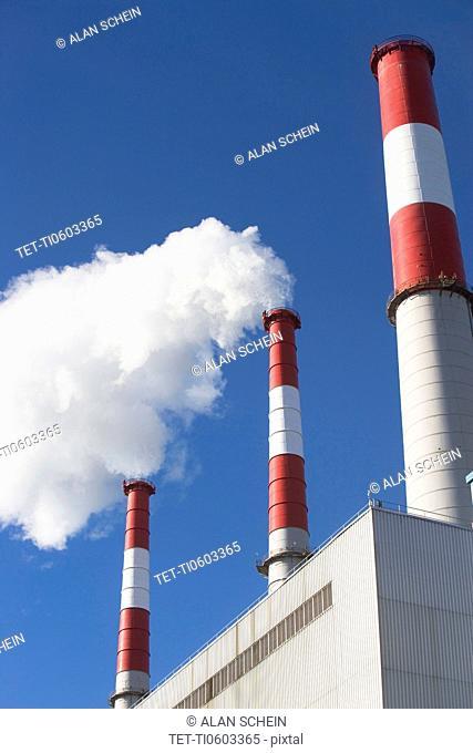 Smoke emitting from smoke stacks