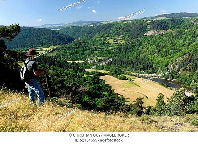 Hiker in the Loire Gorges near Goudet, Haute Loire, Auvergne, France, Europe