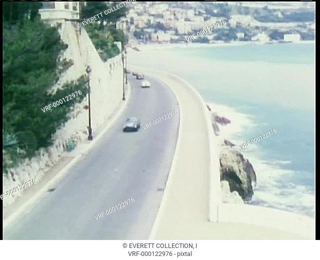Aerial view cars driving along coast line