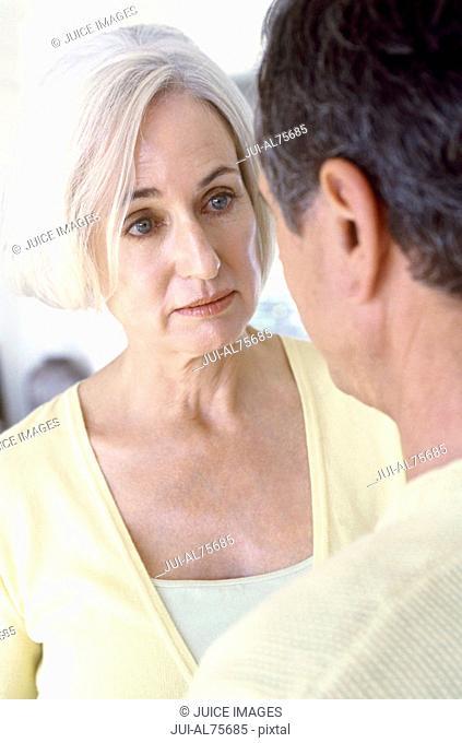 Mature woman talking with husband