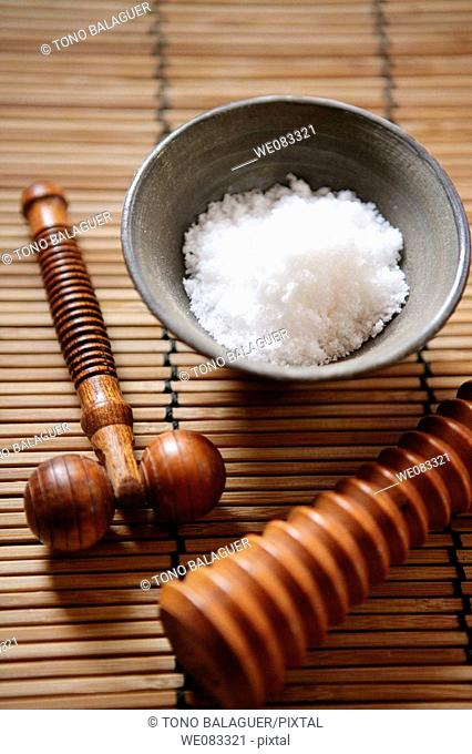 Wooden massage tools with a salt bowl