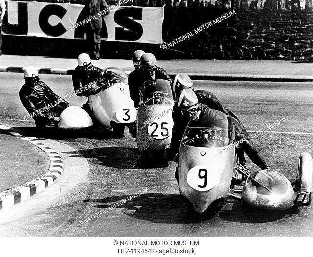 Fritz Scheidegger, Walter Schneider and Helmut Fath competing in a sidecar race, 1959. Schneider, with Hans Strauss, won for the second year running for BMW