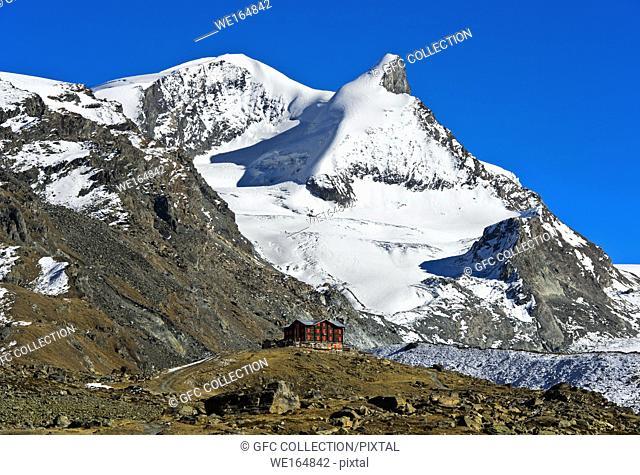 The historical Fluhalp mountain restaurant beneath the peaks Strahlhorn and Adlerhorn, Zermatt, Valais, Switzerland